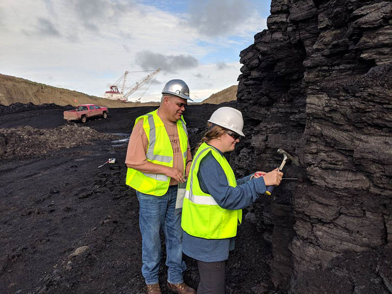 Scientists gathering samples for x-ray spectroscopy testing at a coal mine