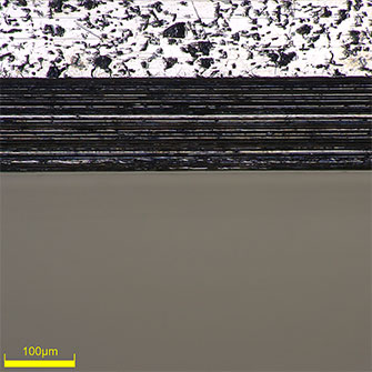High-magnification (500x) image of the edge of a piston ring groove. You can clearly see that the edge is straight