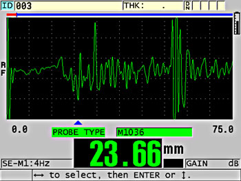 Scatter noise causing false reading. Backwall echo is at right of screen.