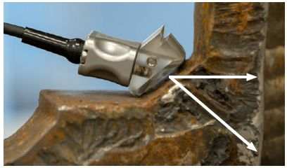The phased array transducer is placed on the angled section of the flange.