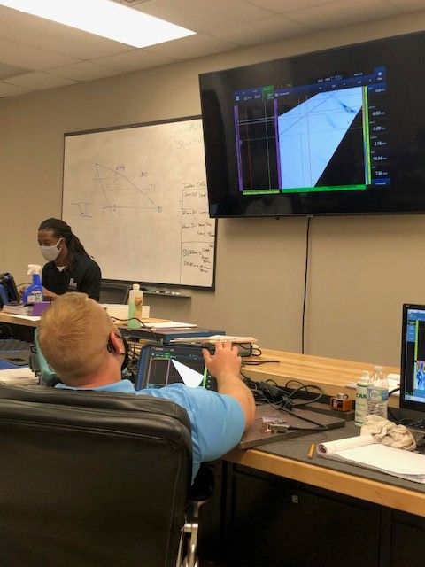 NDT technicians use OmniScan X3 flaw detectors during a PAUT class at Lavender International's training facility in Houston, Texas.